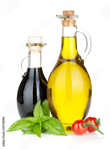 Olive oil, vinegar bottles with basil and tomatoes - 55748140
