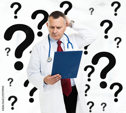 Doctor scratching his head