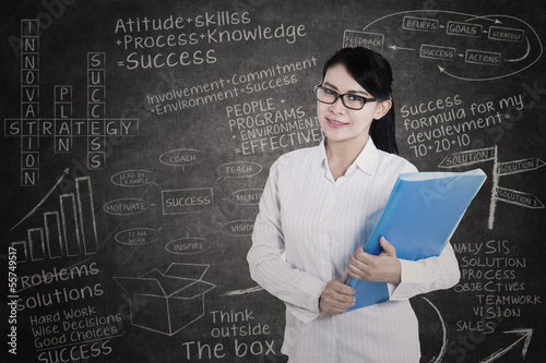 Attractive female medical student in class