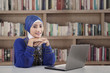 Beautiful muslim girl at library