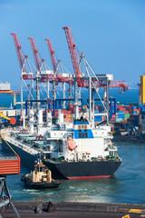 tug boat and cargo ship