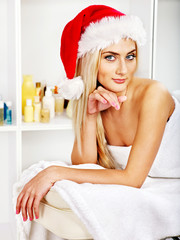 Woman getting massage in Xmas spa.