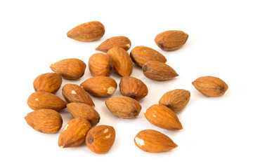 Closeup of several almond seeds, isolated on white background