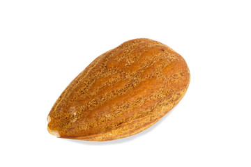 Closeup of an almond seed, isolated on white background