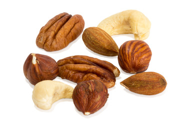 Closeup of mixture of different peanuts, isolated