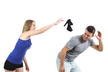 Woman throwing a heel shoe to a man