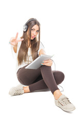 Teenage girl with headphones and tablet pc showing two fingers