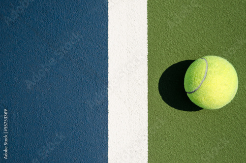 Tennis Ball on one side of the line