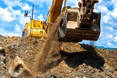 construction excavator moving earth and sand