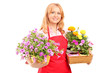 Middle aged female florist holding flowers