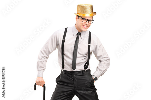 Stylish man with hat holding a cane