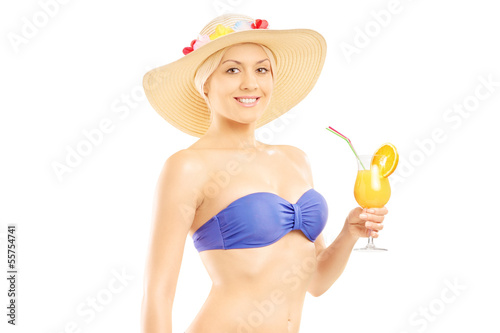 Woman in bikini holding a cocktail