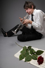 Portrait of a young man playing love his Trumpet