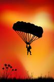 Skydiver on sky background