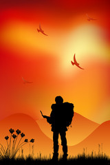 Silhouette of a man of backpacker tourists