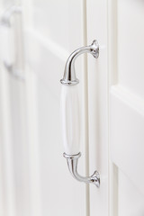 White handle details, white wardrobe
