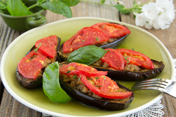 Grilled eggplant with tomatoes and meat.