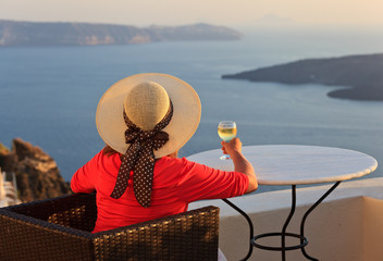 woman with glass of wine at Santorini