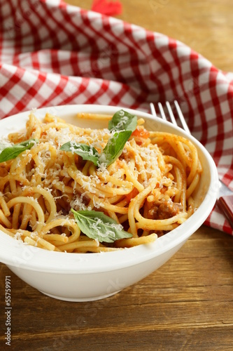 spaghetti pasta with tomato sauce, basil and parmesan cheese