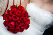 canvas print picture - Bride Holding Red Rose Bouquet