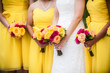 canvas print picture - Bride Holding Bouquet with Bridesmaids in Background