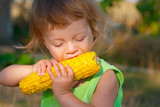 child to eat boiled corncob