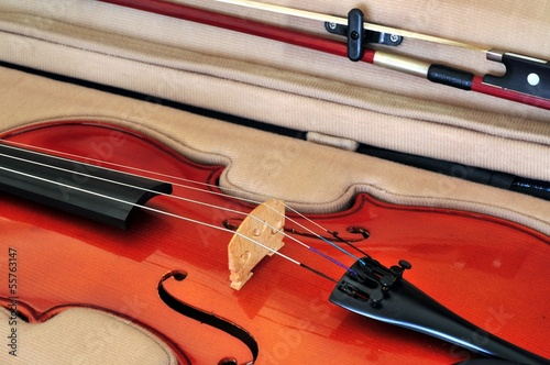 Viola in case showing bridge, fingerboard, tailpiece and bow