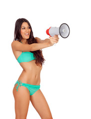 Beautiful woman in bikini with megaphone