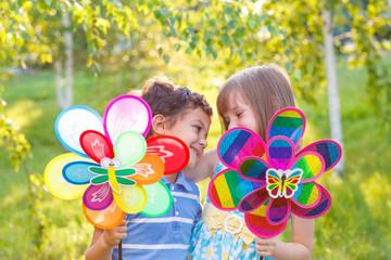 Preschool boy and girl embracing