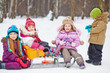Group of children with sledge in winter park