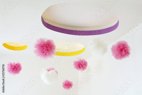 Stylish ceiling with dangling pink and white pom-poms