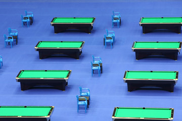 Rows of several billiard tables