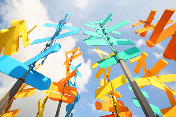 Set of multi-colored vanes and signs on background of blue sky
