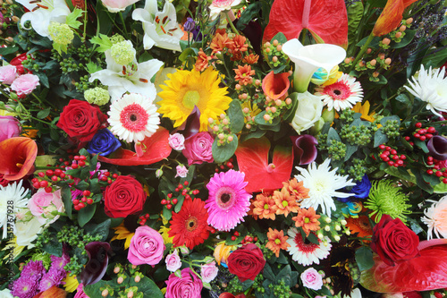 Colorful flowers in large bouquet of callas, lilies, roses