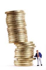Business-Figur Stapel von Münzen