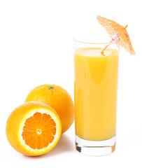 Orange juice and two oranges