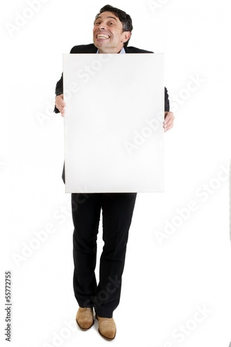 Man with a cheesy grin holding a blank sign