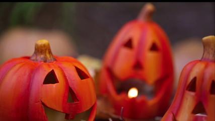 Scary halloween pumpkins jack-o-lantern candle lit. Dolly shot