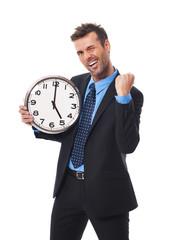 Cheerful businessman finishing his job today