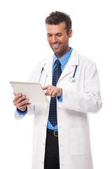Male doctor working on digital tablet