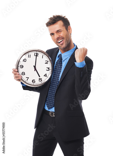 Cheerful businessman finishing his job today