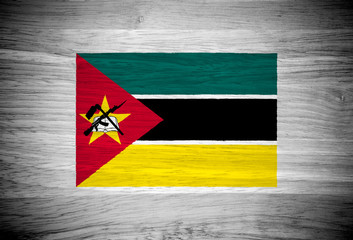 Mozambique flag on wood texture