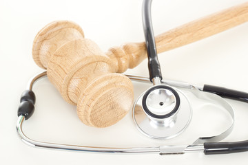 Wooden gavel with black stethoscope