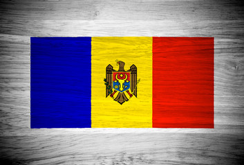 Moldova flag on wood texture