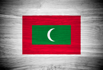 Maldives flag on wood texture