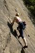 Junge Frau, Klettern
