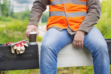 Worker with a coffee