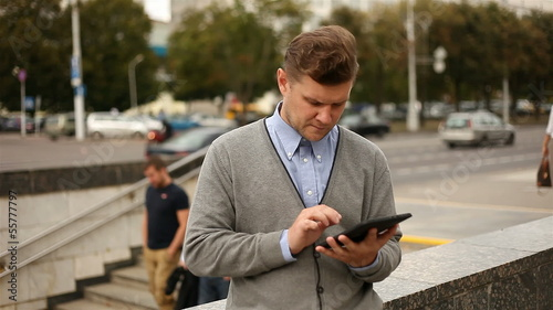 Businessman working on tablet computer by the street, 1080p