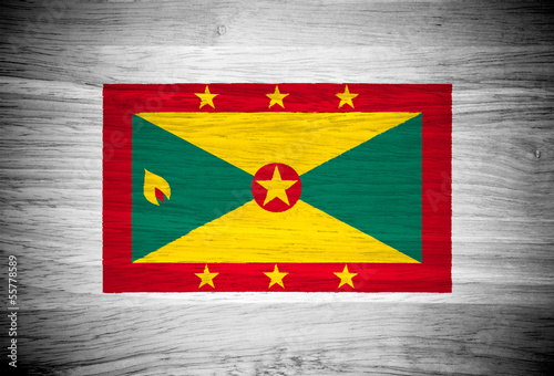 Grenada flag on wood texture