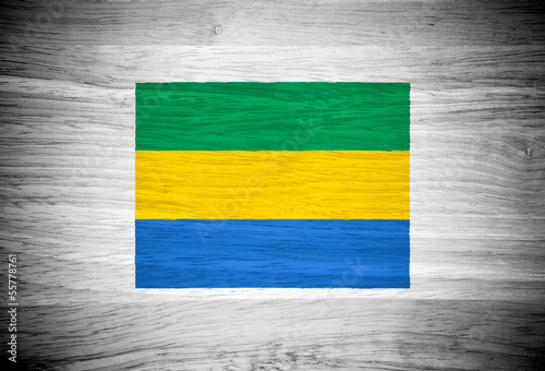 Gabon flag on wood texture